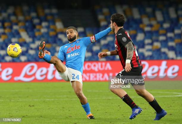 Napoli's Italian striker Lorenzo Insigne controls the ball next to AC Milan's Italian defender Davide Calabria during the Serie A football match SSC...