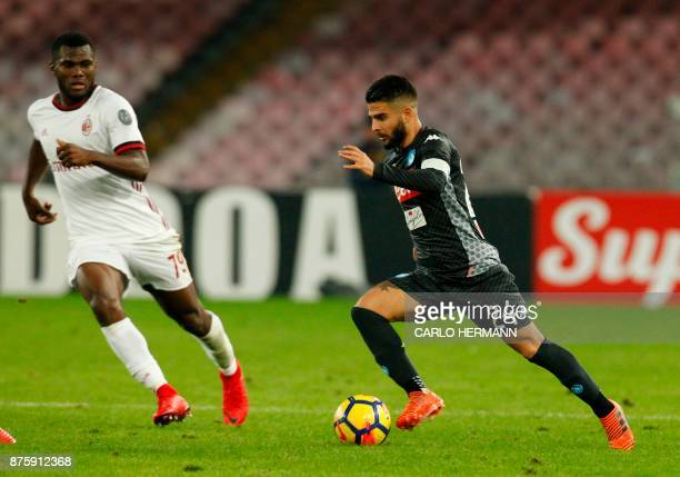 Napoli's Italian striker Lorenzo Insigne controls the ball next to Milan's Ivorian midfielder Franck Kessie during the Italian Serie A football match...