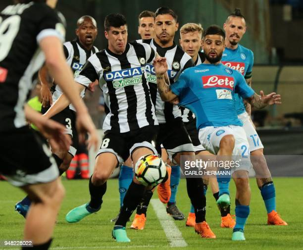 Napoli's Italian striker Lorenzo Insigne fights for the ball with Udinese's Croatian forward Stipe Perica during the Italian Serie A football match...