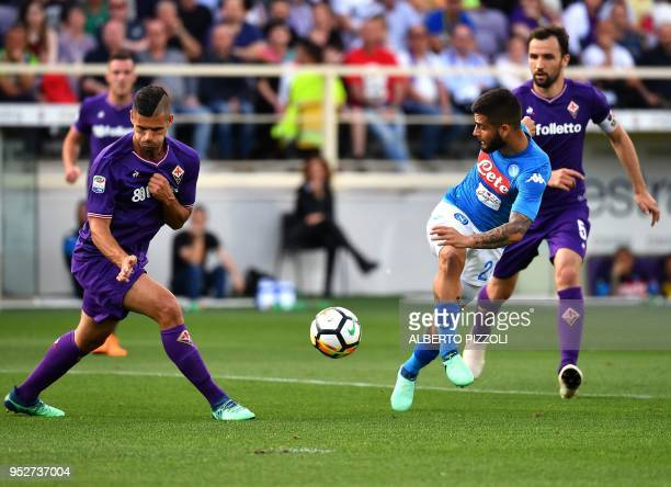 Napoli's Italian striker Lorenzo Insigne fights for the ball with Fiorentina's French defender Vincent Laurini during the Italian Serie A football...
