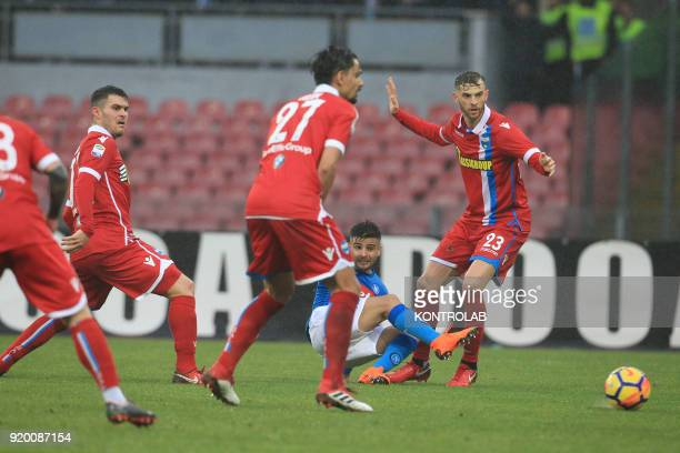 STADIUM NAPLES CAMPANIA ITALY Napoli's Italian striker Lorenzo Insigne kicks the ball next to SPAL's Italian defender Francesco Vicari PAL's Polish...