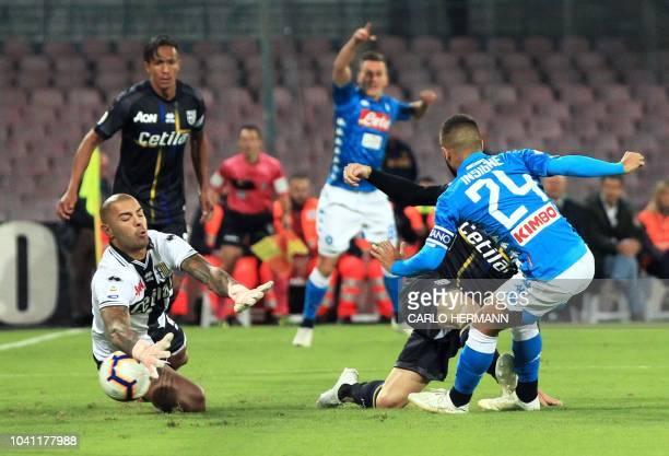 Napoli's Italian striker Lorenzo Insigne scores a goal past Parma's goalkeeper from Italy Luigi Sepe during the Italian Serie A football match...