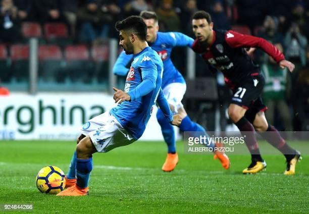 Napoli's Italian striker Lorenzo Insigne scores a penalty kick during the Italian Serie A football match between Cagliari and Napoli at Sardinia...