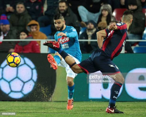 Napoli's Italian striker Lorenzo Insigne vies for the ball with Crotone's Italian defender Davide Faraoni during the Italian Serie A football match...