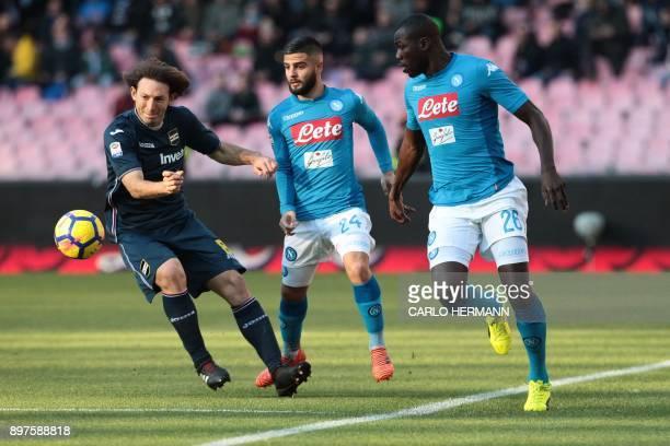 Napoli's Italian striker Lorenzo Insigne vies with Sampdoria's Polish defender Bartosz Bereszynski next Napoli's French defender Kalidou Koulibaly...