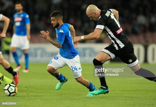 Napoli's Italian striker Lorenzo Insigne vies with Udinese's Dutch defender Bram Nuytinck during the Italian Serie A football match SSC Napoli vs...