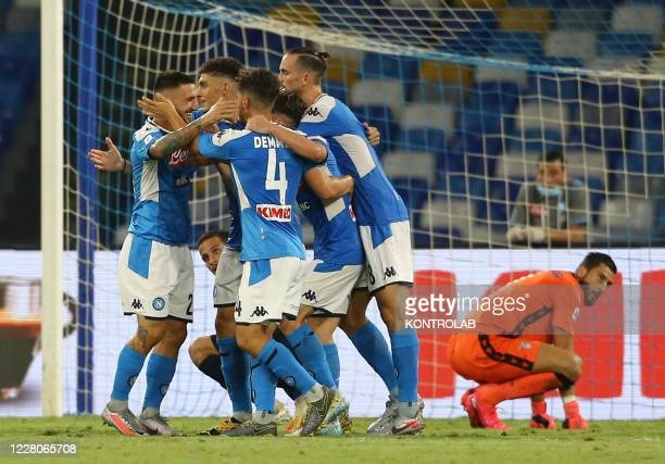 Napoli's Italian striker Matteo Politano celebrates with teammates after scoring a goal with team during the Serie A football match SSC Napoli vs SS...