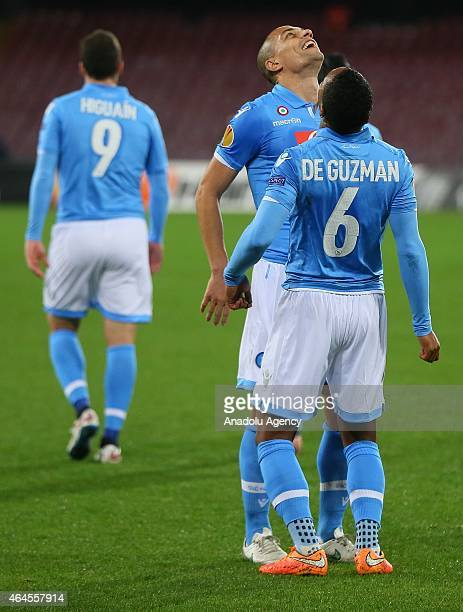 Napoli's Jonathan De Guzman celebrates with his teammate Gokhan Inler after scoring a goal during the UEFA Europa League Round of 32 second leg...