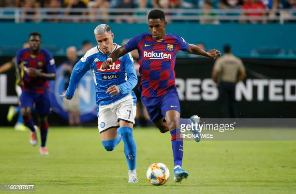Napoli's Jose Callejon vies for the ball against Barcelona's Junior Firpo during the International Champions Cup football match between FC Barcelona...