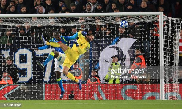 Napoli's Kalidou Koulibaly and Liverpool goalkeeper Alisson Becker battle for the ball during the UEFA Champions League match at Anfield Liverpool