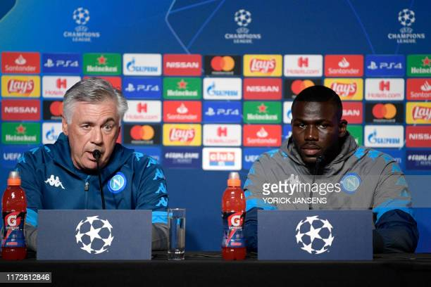 Napoli's Kalidou Koulibaly and Napoli's headcoach Carlo Ancelloti give a press conference before a training session at the Fenix Stadium in Genk on...