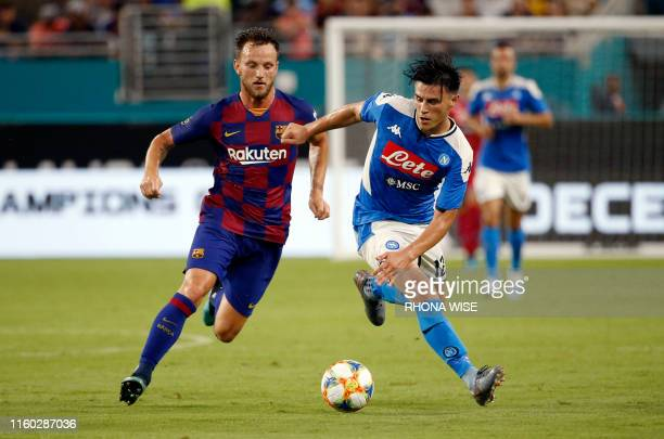 Napoli's Lorenzo Insigne battles for the ball with Barcelona's Ivan Rakitic during the International Champions Cup football match between FC...
