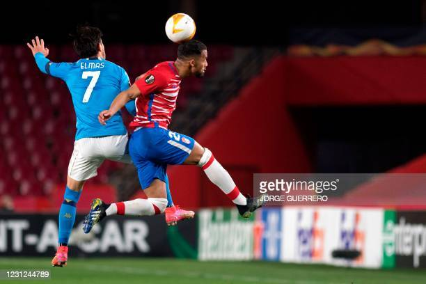 Napoli's Macedonian midfielder Eljif Elmas vies with Granada's Venezuelan midfielder Yangel Herrera during the UEFA Europa League round of 32 first...