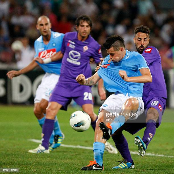 Napoli's Marek Hamsik vies with Fiorentina's Cassani during footall Italian Serie A Match SSC NapoliAc Fiorentina in San Paolo Stadium on September...