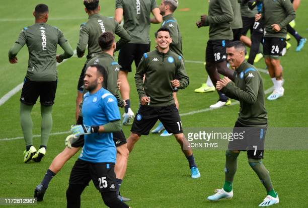 Napoli's Mexican forward Hirving Lozano and teammates take part in a training session at the Fenix Stadium in Genk on October 1 2019 on the eve of...