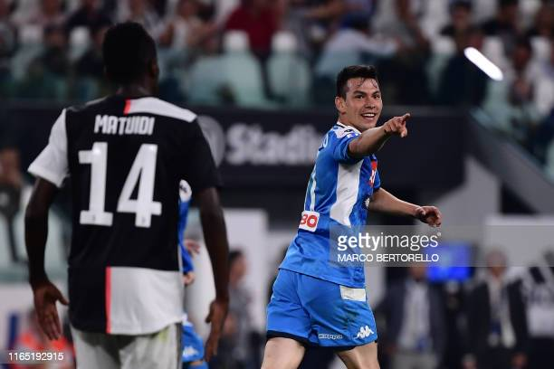 Napoli's Mexican forward Hirving Lozano celebrates after scoring a goal during the Italian Serie A football match Juventus vs Napoli on August 31...