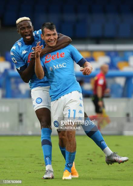 Napoli's Mexican forward Hirving Lozano celebrates with teammate Napoli's Nigerian forward Victor Osimhen after scoring a goal during the Serie A...