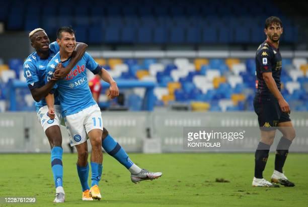 Napoli's Mexican forward Hirving Lozano celebrates with teammate Napoli's Nigerian forward Victor Osimhen after scoring a goal as Genoa's Italian...