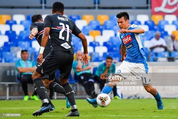 Napoli's Mexican forward Hirving Lozano challenges Sampdoria's Colombian defender Jeison Murillo during the Italian Serie A football match Napoli vs...