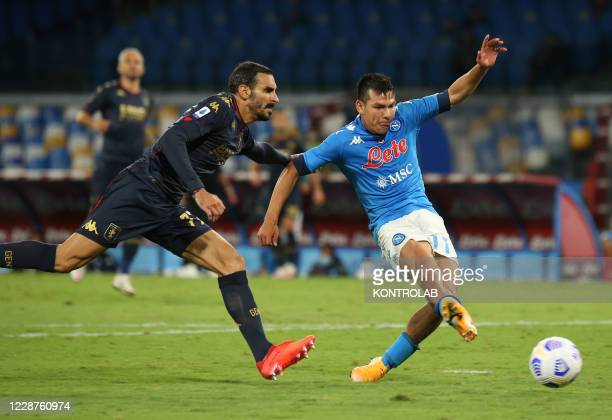Napoli's Mexican forward Hirving Lozano kicks the ball as fighting with Genoa's Italian defender Davide Zappacosta during the Serie A football match...