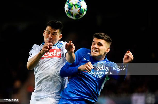 Napoli's Mexican forward Hirving Lozano vies with RC Genk's Romanian midfielder Ianis Hagi during the UEFA Champions League Group E football match...