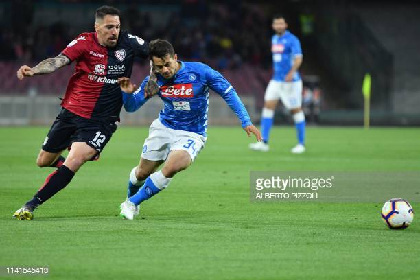 Napoli's midfielder Amin Younes from Germany vies with Cagliari's defender Fabrizio Cacciatore during the Italian Serie A football match Napoli vs...