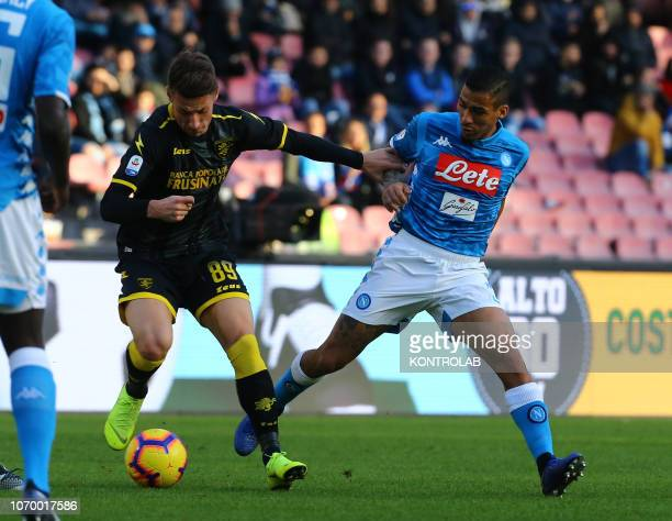 STADIUM NAPLES CAMPANIA ITALY Napoli's midfielder from Brazil Allan fights for the ball with Frosinone's Italian forward Andrea Pinamonti during the...