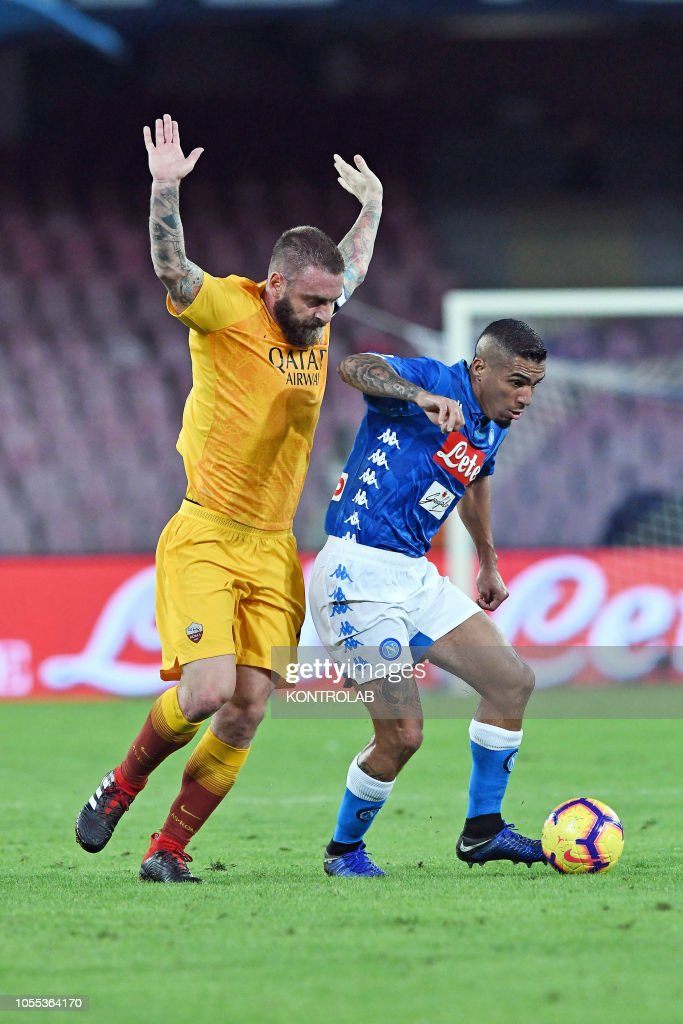 napoli s midfielder from brazil allan fights for the ball with