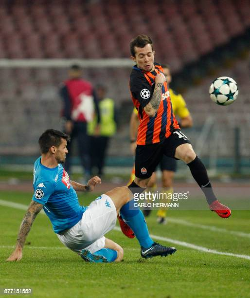 Napoli's midfielder from Italy Christian Maggio fights for the ball with Shakhtar Donetsk's Brazilian midfielder Bernard during the UEFA Champions...
