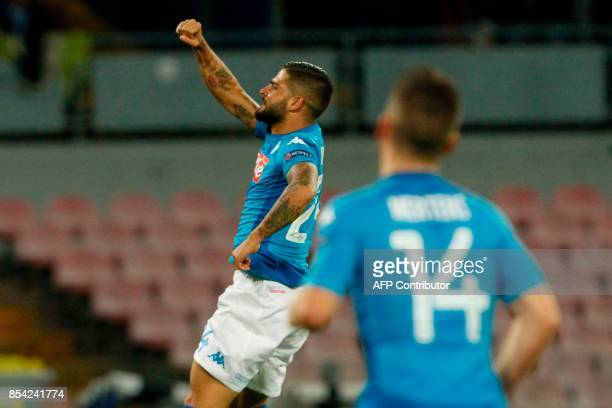 Napoli's midfielder from Italy Lorenzo Insigne celebrates after scoring during the UEFA Champion's League Group F football match Napoli vs Feyenoord...