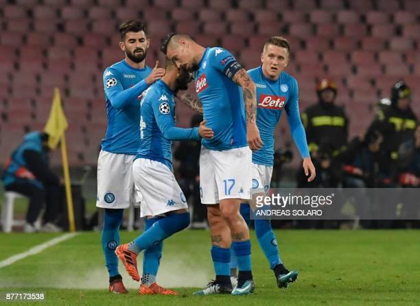 Napoli's midfielder from Italy Lorenzo Insigne celebrates with teammates Napoli's defender from Albania Elseid Hysaj Napoli's midfielder from...
