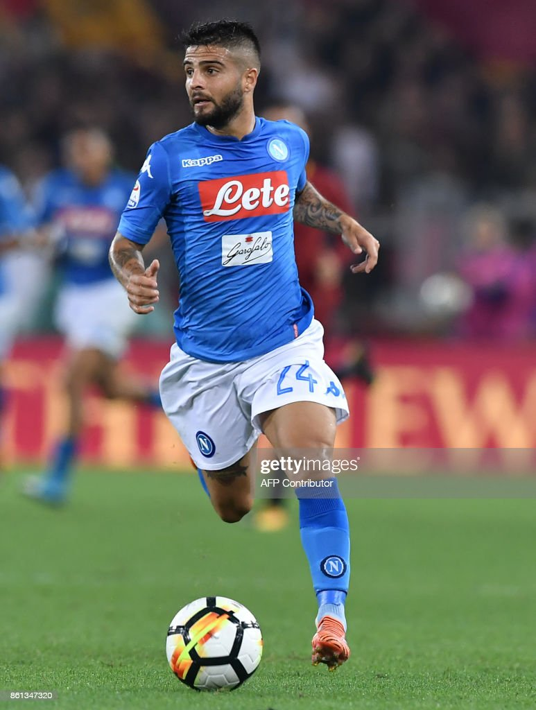 Napoli's midfielder from Italy Lorenzo Insigne controls the ball during the Italian Serie A football match Roma vs Napoli at the Olympic Stadium in Rome on October 14, 2017. /