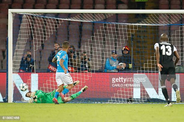 Napoli's midfielder from Italy Lorenzo Insigne misses a penalty against Besiktas' goalkeeper from Spain Fabricio during the UEFA Champions League...