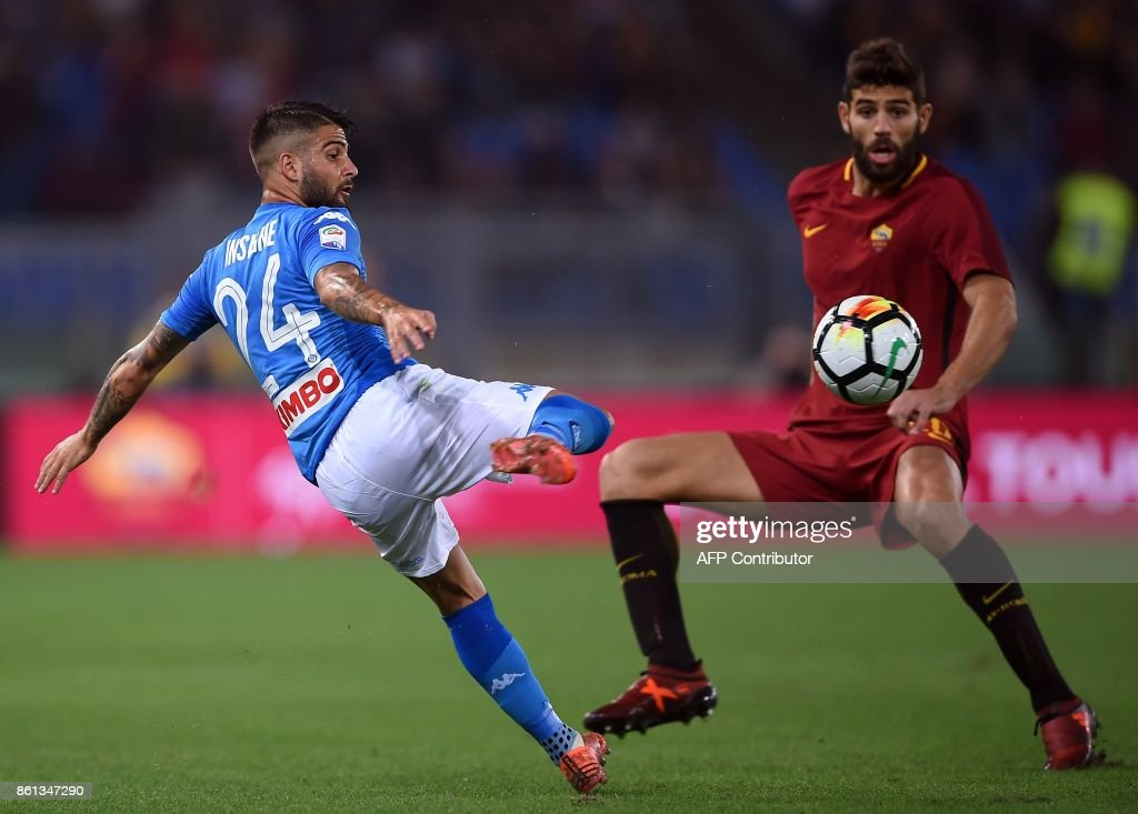 Napoli's midfielder from Italy Lorenzo Insigne (L) vies with Roma's defender from Argentina Federico Fazio during the Italian Serie A football match Roma vs Napoli at the Olympic Stadium in Rome on October 14, 2017. /