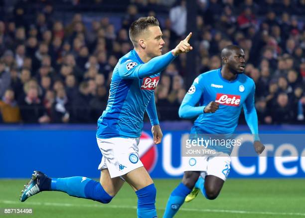 Napoli's midfielder from Poland Piotr Zielinski celebrates after scoring a goal during the UEFA Champions League Group F football match between...