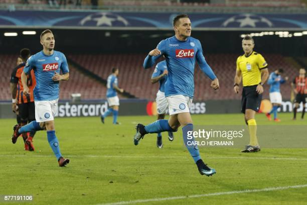 Napoli's midfielder from Poland Piotr Zielinski celebrates after scoring during the UEFA Champions League Group F football match Napoli vs Shakhtar...
