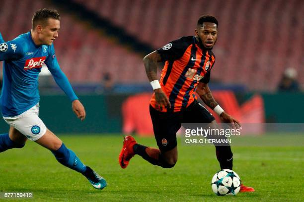 Napoli's midfielder from Poland Piotr Zielinski vies with Shakhtar Donetsk's Brazilian midfielder Fred during the UEFA Champions League Group F...