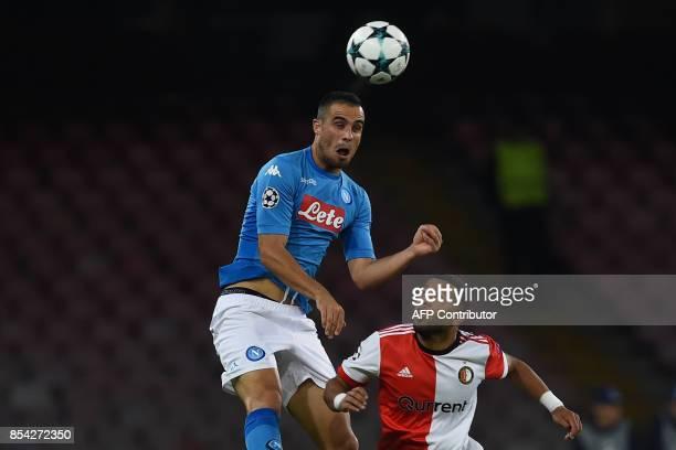Napoli's midfielder from Serbia Nikola Maksimovic heads the ball next to Feyenoord's Dutch midfielder Tonny Vilhena during the UEFA Champion's League...