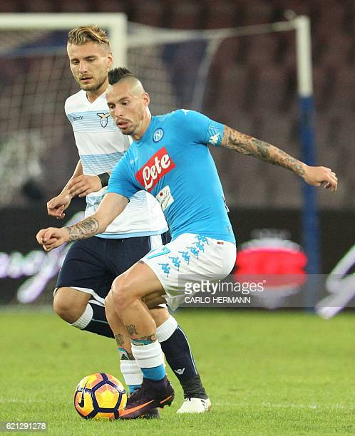 Napoli's midfielder from Slovakia Marek Hamsik fights for the ball with Lazio's forward from Italy Ciro Immobile during the Italian Serie A football...