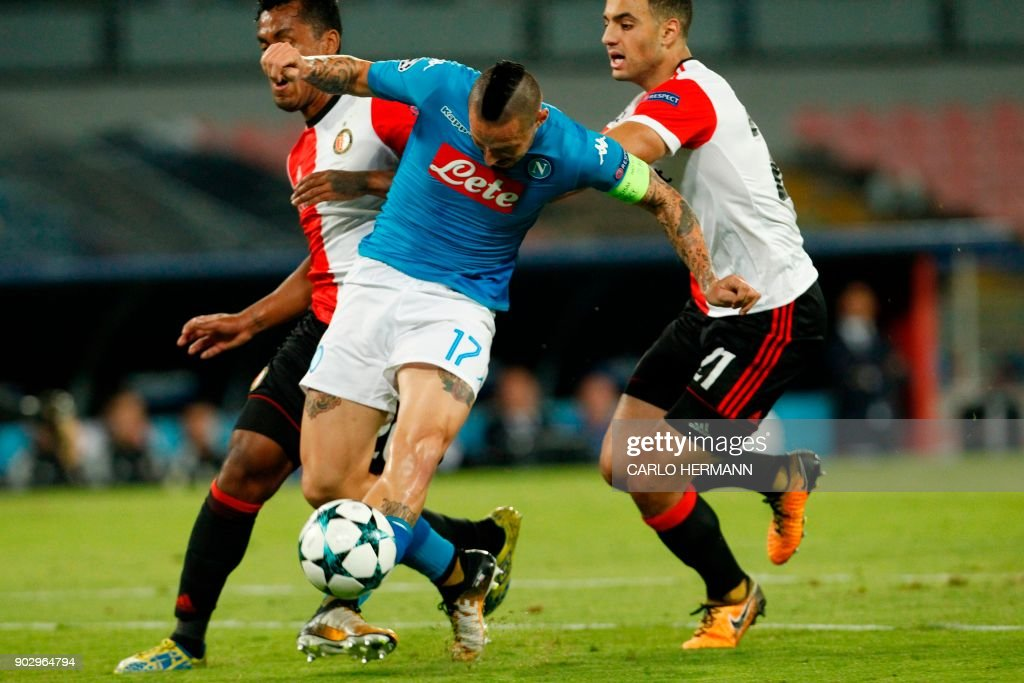 Napoli's midfielder from Slovakia Marek Hamsik (C) fights for the ball with Feyenoord's Peruvian midfielder Renato Tapia and Feyenoord's Moroccan midfielder Sofyan Amrabat (R) during the UEFA Champion's League Group F football match Napoli vs Feyenoord Rotterdam on September 26, 2017 at the San Paolo stadium in Naples. / AFP PHOTO / Carlo Hermann