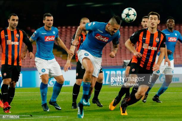 Napoli's midfielder from Slovakia Marek Hamsik heads the ball during the UEFA Champions League Group F football match Napoli vs Shakhtar Donetsk on...