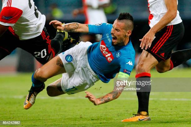 Napoli's midfielder from Slovakia Marek Hamsik reacts during the UEFA Champion's League Group F football match Napoli vs Feyenoord Rotterdam on...
