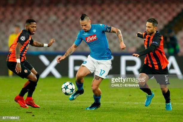 Napoli's midfielder from Slovakia Marek Hamsik vies with Shakhtar Donetsk's Brazilian midfielder Fred and Shakhtar Donetsk's Brazilian midfielder...