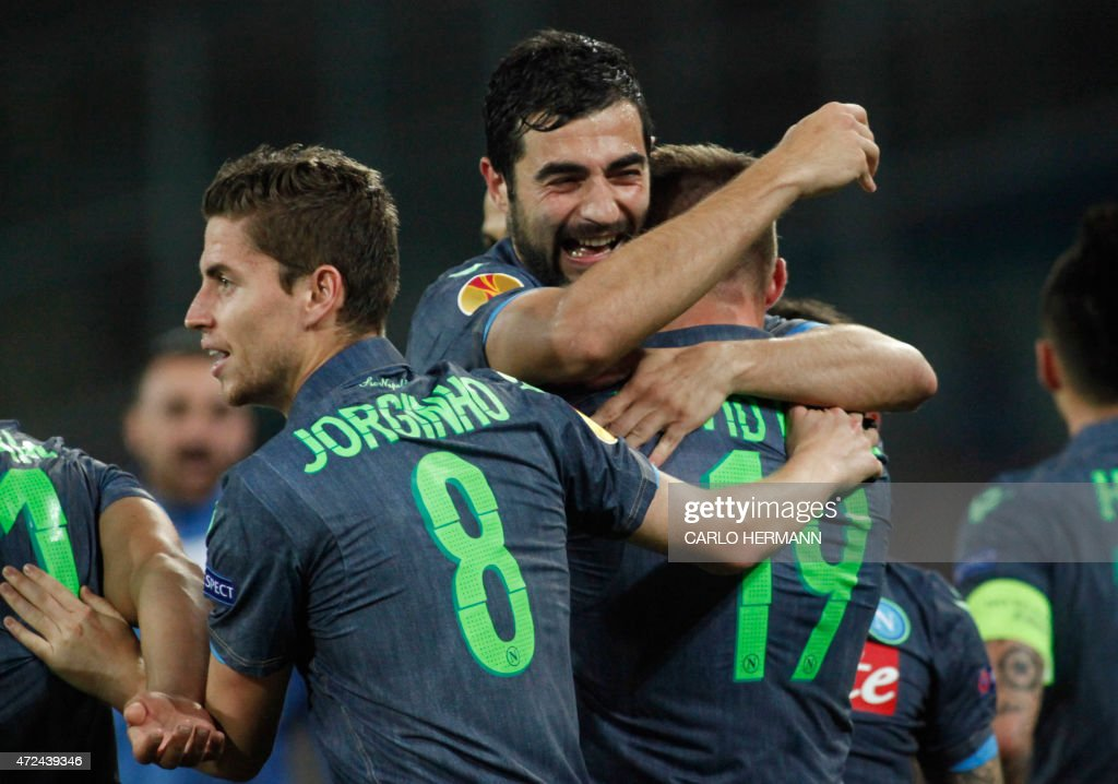 Napoli's midfielder from Spain David Lopez (R) celebrates with teammates Napoli's midfielder from Brazil Jorginho (L) and Napoli's defender from Spain Raul Albiol after scoring during the UEFA Europa League semi final first leg football match SSC Napoli vs FK Dnipro Dnipropetrovsk on May 7, 2015 at the San Paolo Stadium in Naples.
