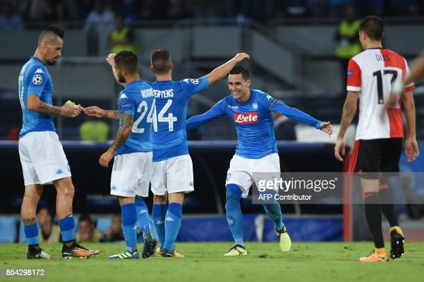 Napoli's midfielder from Spain Jose Maria Callejon celebrates with teammates Napoli's forward from Belgium Dries Mertens Napoli's midfielder from...