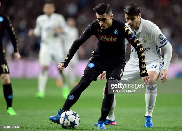 Napoli's midfielder from Spain Jose Maria Callejon vies with Real Madrid's forward Alvaro Morata during the UEFA Champions League round of 16 first...
