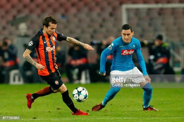 Napoli's midfielder from Spain Jose Maria Callejon vies with Shakhtar Donetsk's Brazilian midfielder Bernard during the UEFA Champions League Group F...