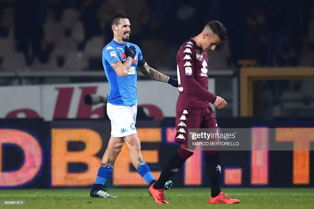 Napoli's midfielder Marek Hamsik (L) from Slovakia celebrates after scoring during the Italian Serie A football match Torino Vs Napoli on December 16, 2017 at the 'Grande Torino' stadium in Turin. Marek Hamsik equalled Diego Maradona's record as Napoli's all-time top goalscorer as they took advantage of Inter Milan's first defeat of the season and moved top of Serie A with a 3-1 win at Torino. /