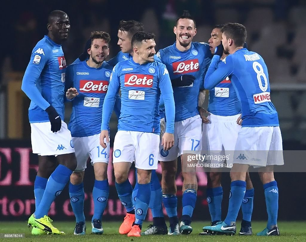 Napoli's midfielder Marek Hamsik from Slovakia (2ndR) celebrates with teammates after scoring during the Italian Serie A football match Torino Vs Napoli on December 16, 2017 at the 'Grande Torino' stadium in Turin. /