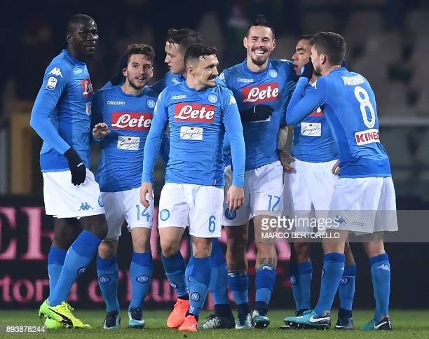 Napoli's midfielder Marek Hamsik from Slovakia celebrates with teammates after scoring during the Italian Serie A football match Torino Vs Napoli on...